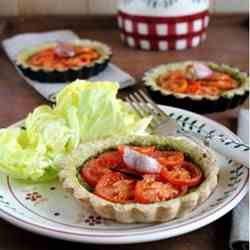 Whole tomatoes and pesto tartlets with van
