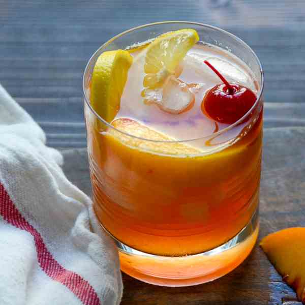 fresh peach and bourbon sour