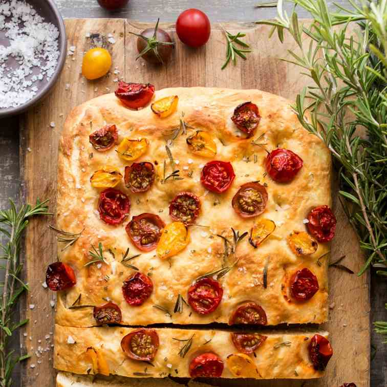Vegan focaccia with tomatoes and rosemary