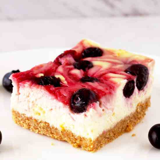 Mixed Berry Swirl Cheesecake Bars