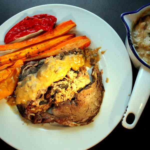 Stuffed Beef Roast Roll with Mushroom Sauc