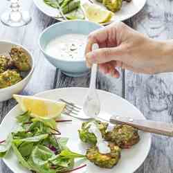 Pea fritters with yogurt mint sauce