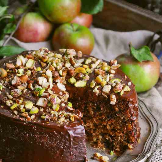 A chocolate-peanut cake with apples