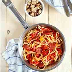 Spaghetti with pepperoni, peppers and toas