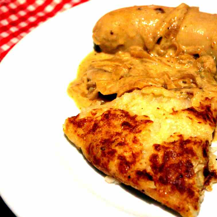 Roesti with Bratwurst and Onion Sauce