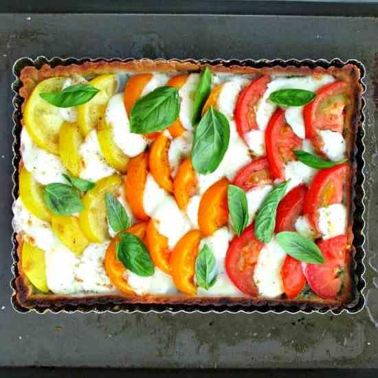 an introduction to fresh mozzarella and pesto tart