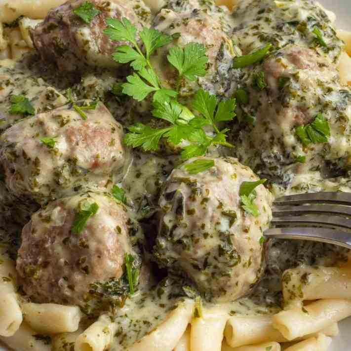 Meatball pasta in creamy green sauce