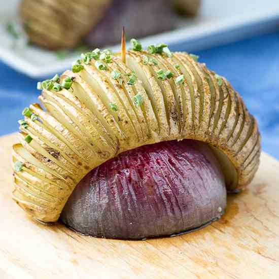 Hasselback Potatoes Over Roasted Red Onion