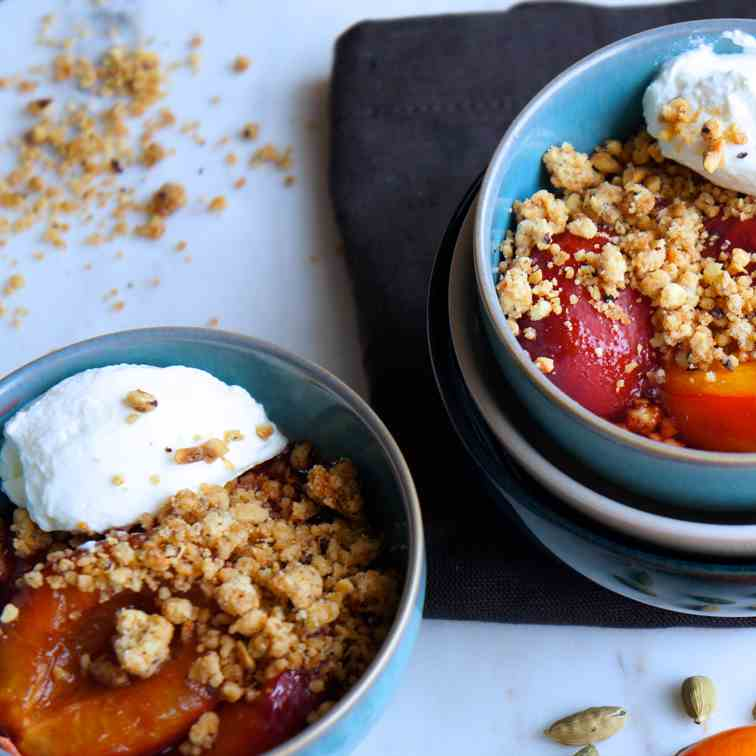 Baked plums with cardamom and nutty crumbl